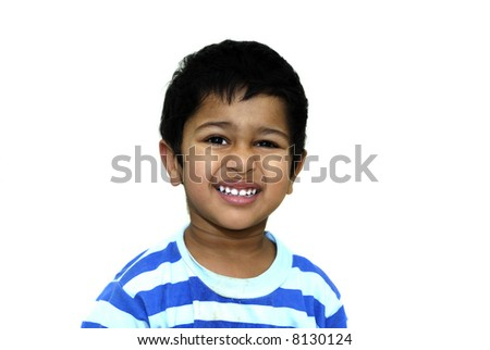 an handsome indian kid looking shy after a prank - stock photo
