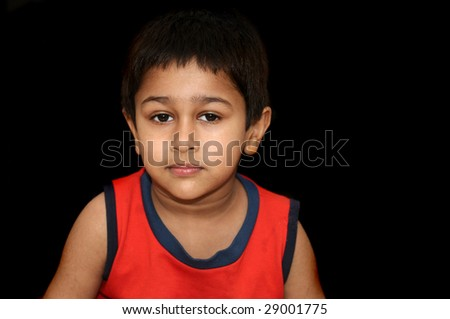 An handsome Indian kid looking very gloomy and sad - stock photo