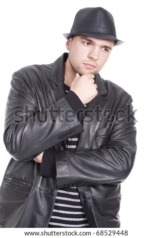 an handsome young man thinking with a hat on - stock photo