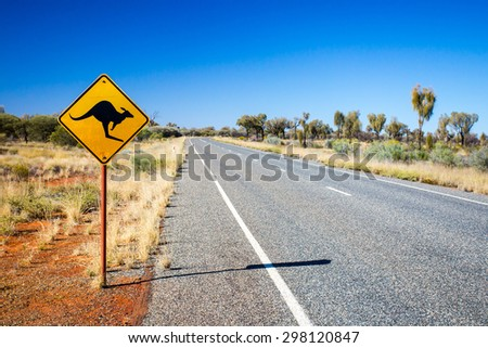 An iconic warning road sign for kangaroos near Uluru in Northern Territory, Australia - stock photo