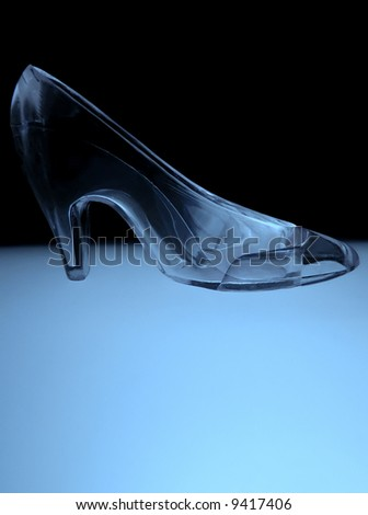 an illuminated glass slipper in cool blue tones - stock photo