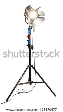 An illuminated studio light on a stand. Isolated on a white background. - stock photo