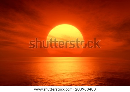 An image of a beautiful red sunset over the ocean - stock photo