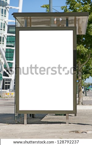 An image of a bus stop with a blank bilboard for your advertising situated in front of the turning torso skyscraper in the swedish city of Malmo. - stock photo