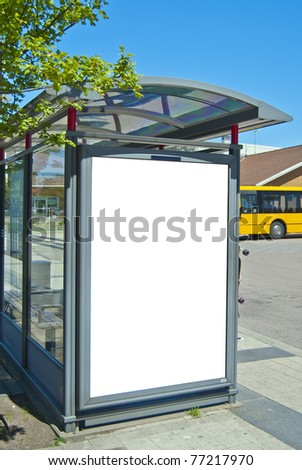 An image of a bus stop with a blank bilboard for your advertising situated in the swedish city of Bastad. - stock photo