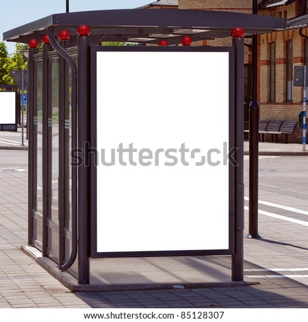 An image of a bus stop with a blank bilboard for your advertising situated in the swedish city of Angelholm. - stock photo