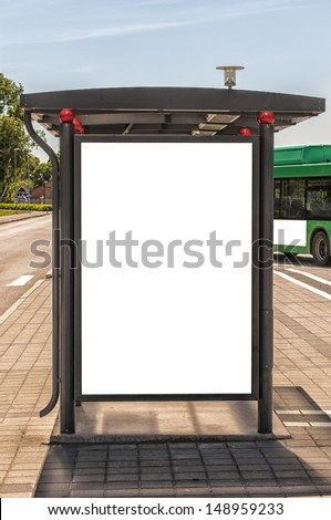 An image of a bus stop with a blank billboard for your advertising situated in the swedish city of Angelholm. - stock photo