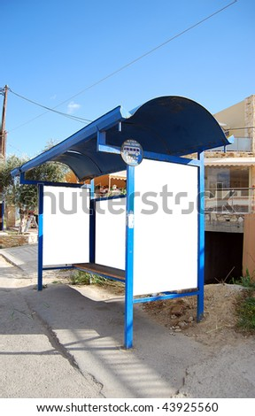An image of a bus stop with a blank billboard for your advertising situated on the greek island of crete. - stock photo