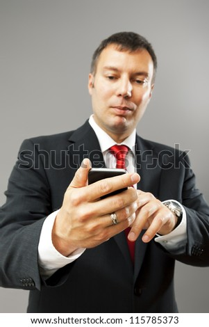 An image of a business man with his mobile phone - stock photo