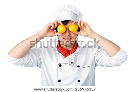 An image of a chef with lemons on his eyes - stock photo