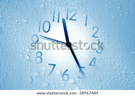 an image of a clock on waterdrop background - stock photo