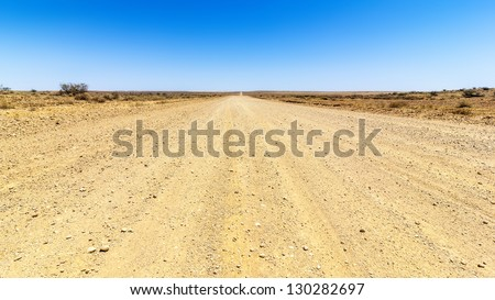 An image of a desert road to the horizon - stock photo