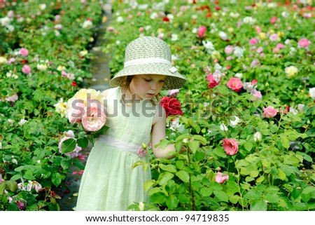 An image of a girl in a greenhouse - stock photo