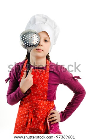 An image of a girl with a colander in her hands - stock photo