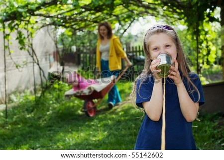 An image of a girl with a toy-telephone - stock photo