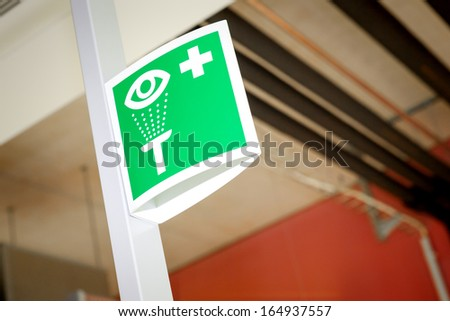 An image of a green laboratory eye sign - stock photo