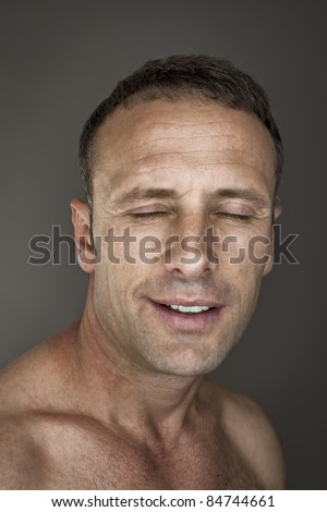 An image of a handsome man with closed eyes - stock photo