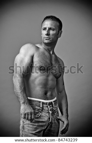 An image of a handsome muscle man black and white - stock photo