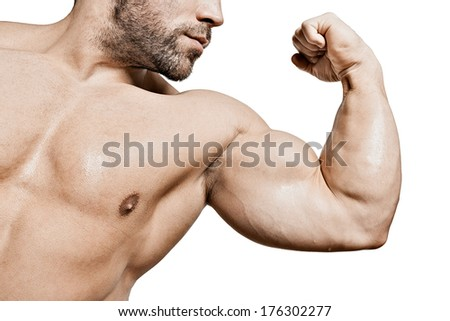 An image of a handsome young muscular sports man flexing his bicep - stock photo