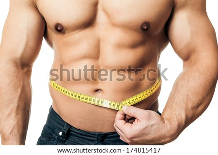 An image of a handsome young muscular sports man measure - stock photo