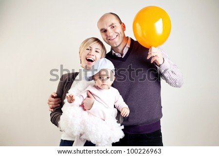 An image of a happy family of three - stock photo
