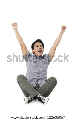 An image of a happy young man on an Indian sit position isolated on - stock photo