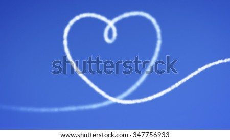 An image of a heart in the blue sky - stock photo