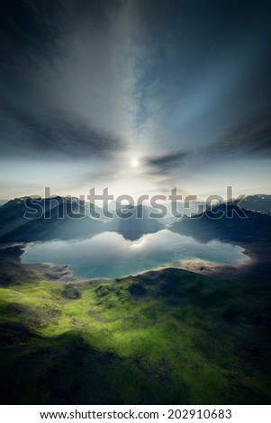 An image of a landscape with lake and sun - stock photo