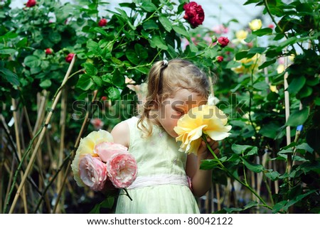 An image of a little girl in a greenhouse - stock photo