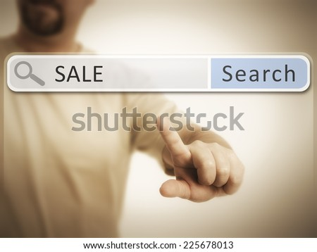 An image of a man who is searching the web after sale - stock photo