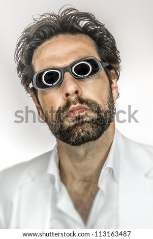 An image of a man with cool sun glasses - stock photo
