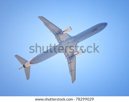 An image of a nice airplane in the blue sky - stock photo