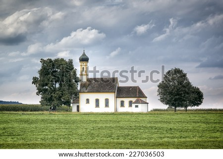An image of a nice church at Raisting Bavaria Germany - stock photo