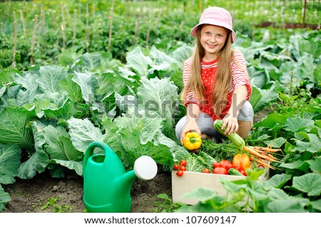 An image of a nice little girl in the kitchen-garden - stock photo
