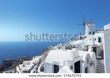 An image of a nice mill at Santorini Greece - stock photo