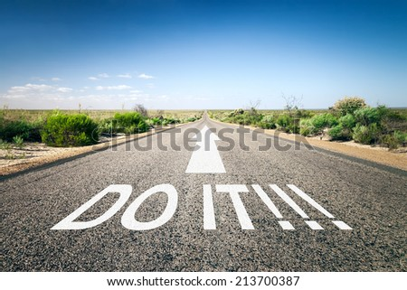 An image of a road to the horizon with text do it!!! - stock photo