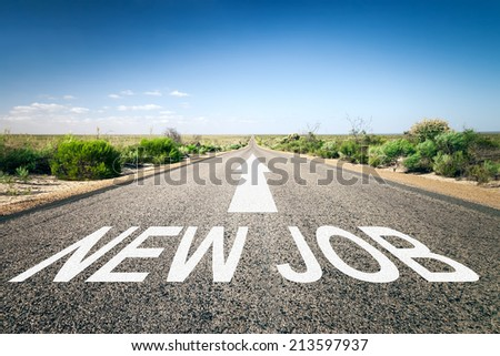 An image of a road to the horizon with text new job - stock photo