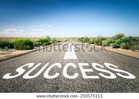 An image of a road to the horizon with text success - stock photo