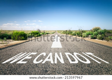 An image of a road to the horizon with text we can do it - stock photo