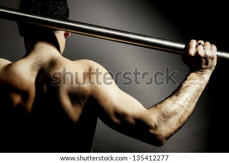 An image of a strong mans back - stock photo