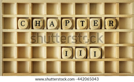 An image of a wooden game with the word chapter three - stock photo