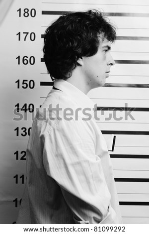 An image of a young man in prison - stock photo