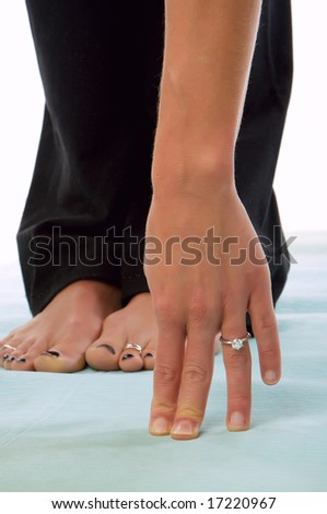 An image of a young woman doing yoga exercises - stock photo