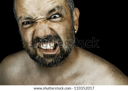 An image of an angry man with a beard - stock photo