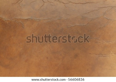 An image of an old worn leather surface. - stock photo