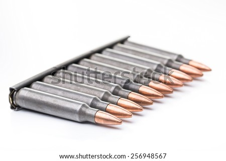 an image of ar15 m16 m4 kalashnikov cartridges with ammo clip isolated on white - stock photo
