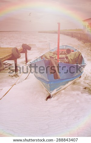 An image of boat moored in the harbor - stock photo