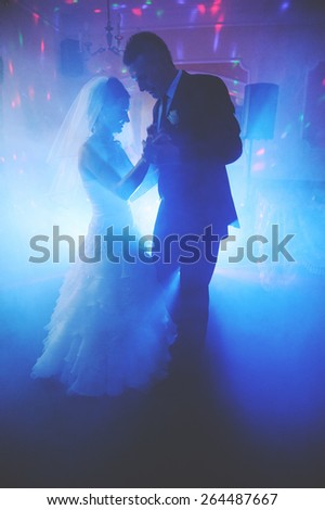an image of bride and groom dancing the first dance at their wedding day - stock photo