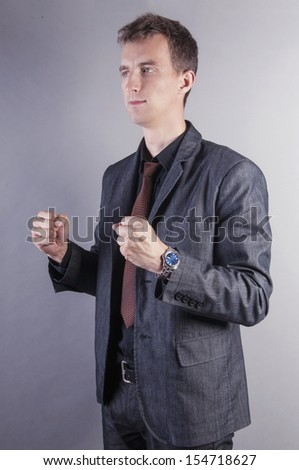 an image of businessman with clenched fists - stock photo