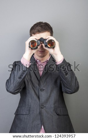 An image of businessmen looking through binocular - stock photo